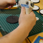 Nail in center of wheel and hotglue the servo horn